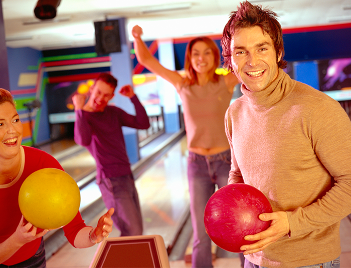 Group of people bowling